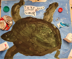 Drawing of a turtle surrounded by litter