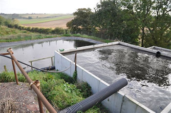 drained-water-is-stored-to-be-returned-to-windrow